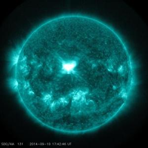 Today's solar flare is visible in the center of the sun. The Solar Dynamics Observatory captured the image in the 131 angstrom range. Courtesy NASA/SDO.