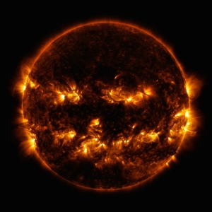 This photo, obtained by NASA's Solar Dynamics Observatory, shows active regions on the Sun. The image looks like a jack-o-lantern! Our star's active regions, located in the corona, are those that emit more light and energy than other areas.  The image is a blend of two images captured in the ultraviolet wavelength at a range that is typically orange or yellow in color. Courtesy NASA/Solar Dynamics Observatory.